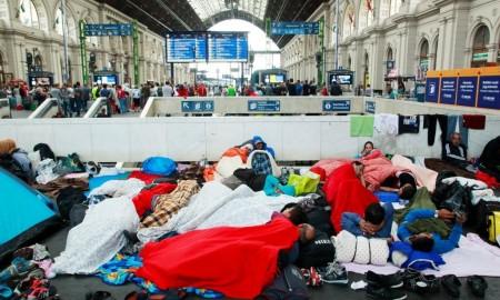 Refugees wait outside Budapest station
