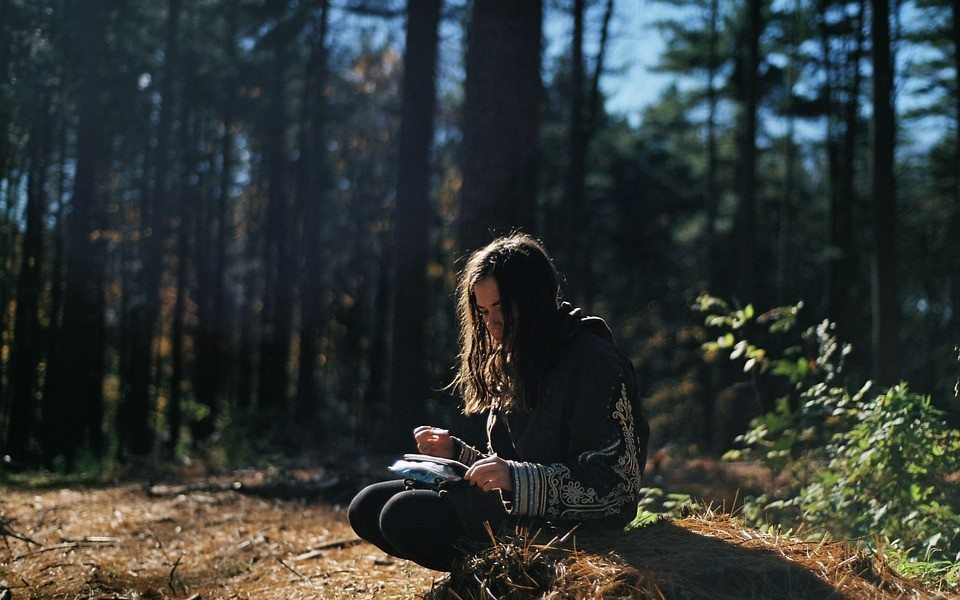girl reading in forest