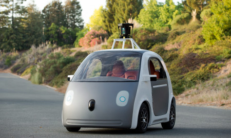 This image provided by Google shows a very early version of Google's prototype self-driving car. The two-seater won't be sold publicly, but Google on Tuesday, May 27, 2014 said it hopes by this time next year, 100 prototypes will be on public roads. (AP Photo/Google)
