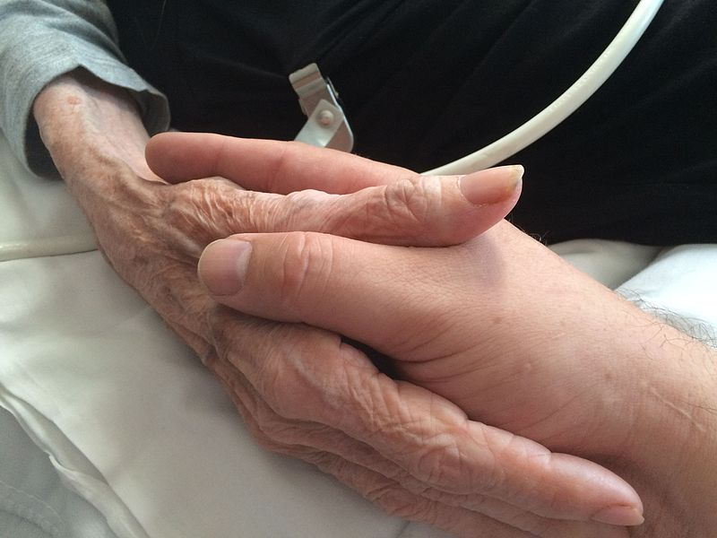 Mother_and_son_holding_hands
